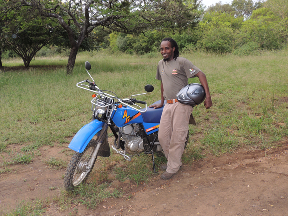 Zama Ncube with the motorbike sponsored by Race4Rhino