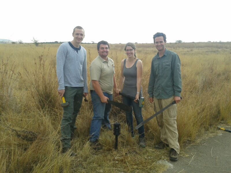 Volunteers with a camera trap