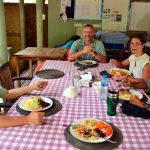 Volunteers enjoying a meal. Photo by Paul Hayes